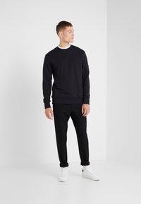 J.LINDEBERG - STORM HEAVY  - Sweatshirt - black - 1