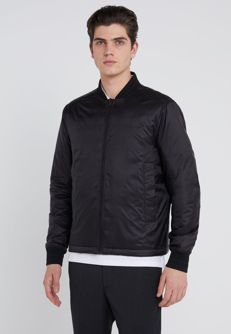 J.LINDEBERG - PIONEER GLOSSY - Light jacket - black