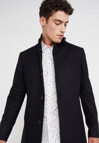 J.LINDEBERG - HOLGER COMPACT MELTON - Classic coat - black - 3
