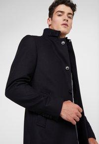 J.LINDEBERG - HOLGER COMPACT MELTON - Classic coat - black - 4