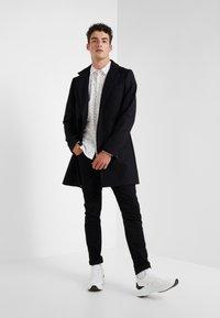 J.LINDEBERG - HOLGER COMPACT MELTON - Classic coat - black - 1