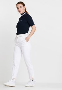 J.LINDEBERG - GIO PANT - Trousers - white - 1