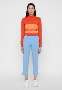 J.LINDEBERG - GRETHA - Trousers - lake blue - 1