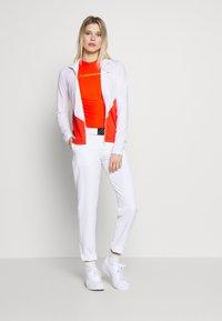 J.LINDEBERG - LIZA LIGHT MID - Training jacket - white - 1