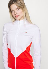 J.LINDEBERG - LIZA LIGHT MID - Training jacket - white - 4
