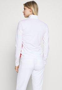 J.LINDEBERG - LIZA LIGHT MID - Training jacket - white - 2