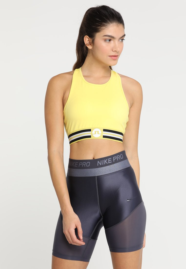 J.LINDEBERG - ALEXIS COMPRESSION - Sports bra - butter yellow