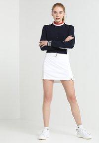 J.LINDEBERG - AMELIE - Sportovní sukně - white - 1