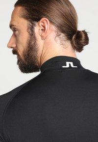 J.LINDEBERG - AELLO SOFT COMPRESSION - Langærmede T-shirts - black - 4