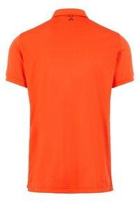 J.LINDEBERG - TOUR TECH - Sports shirt - tomato red - 1