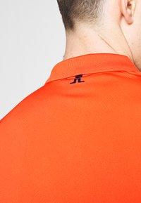 J.LINDEBERG - HEATH REG FIT TX JERSEY - Funkční triko - tomato red - 5