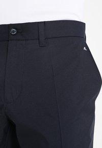 J.LINDEBERG - ELOF TIGHT FIT - Outdoorové kalhoty - navy - 5