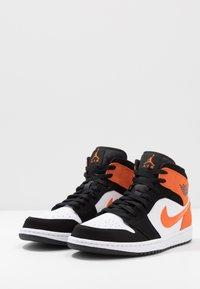 Jordan - AIR 1 MID - Sneaker high - black/starfish/white - 2