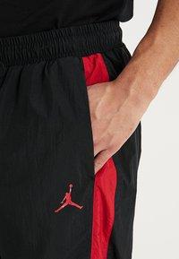 Jordan - DIAMOND CEMENT PANT - Spodnie treningowe - black/gym red - 3