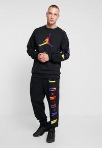 Jordan - PANT - Träningsbyxor - black - 1