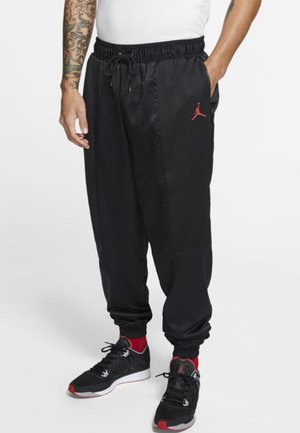 WINGS SUIT PANT - Tracksuit bottoms - black