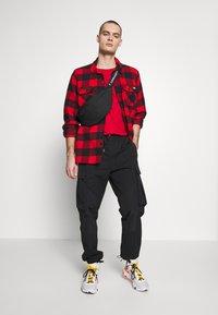 Jordan - PANT - Pantaloni cargo - black - 1