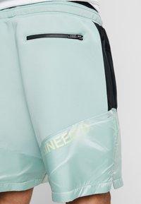 Jordan - Pantalones deportivos - quartz/black/luminous green - 6
