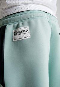 Jordan - Pantalones deportivos - quartz/black/luminous green - 4