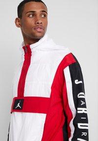 Jordan - WINGS WINDWEAR JACKET - Windbreaker - white/gym red/black/ - 3