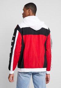 Jordan - WINGS WINDWEAR JACKET - Windbreaker - white/gym red/black/ - 2