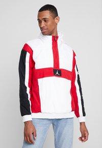 Jordan - WINGS WINDWEAR JACKET - Windbreaker - white/gym red/black/ - 0