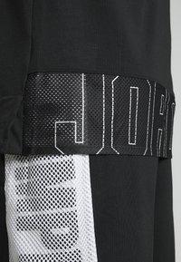 Jordan - 23ALPHA - Tekninen urheilupaita - black - 5
