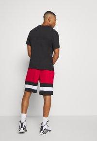 Jordan - JUMPMAN CREW - Print T-shirt - black/white - 2
