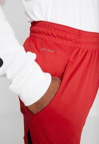 Jordan - ALPHA DRY PANT - Pantalon de survêtement - gym red/black - 3