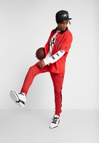Jordan - ALPHA DRY PANT - Pantalon de survêtement - gym red/black - 1