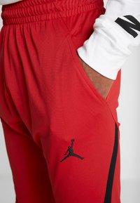Jordan - ALPHA DRY PANT - Pantalon de survêtement - gym red/black - 4