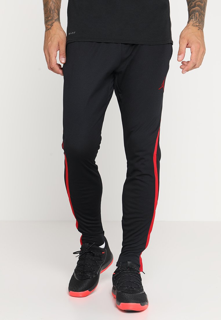 Jordan - ALPHA DRY PANT - Pantalon de survêtement - black/gym red