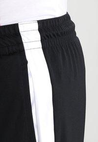 Jordan - ALPHA DRY - Sports shorts - black/white/white - 3