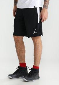 Jordan - ALPHA DRY - Sports shorts - black/white/white - 0