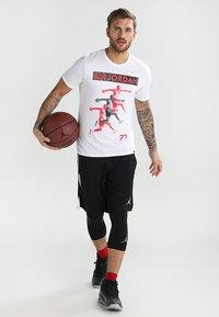 Jordan - ALPHA DRY - Sports shorts - black/white/white - 1
