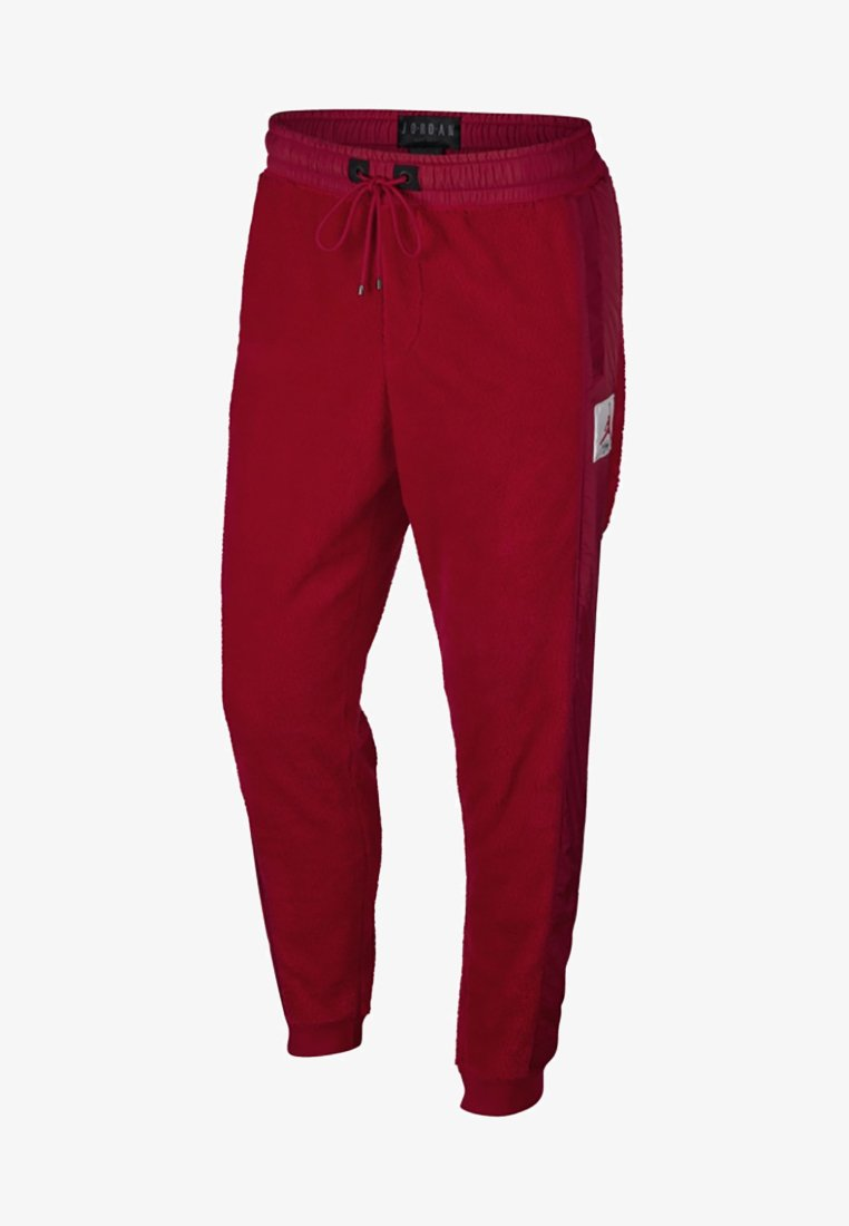 Jordan - WINGS OF FLIGHT PANT - Verryttelyhousut - gym red/black