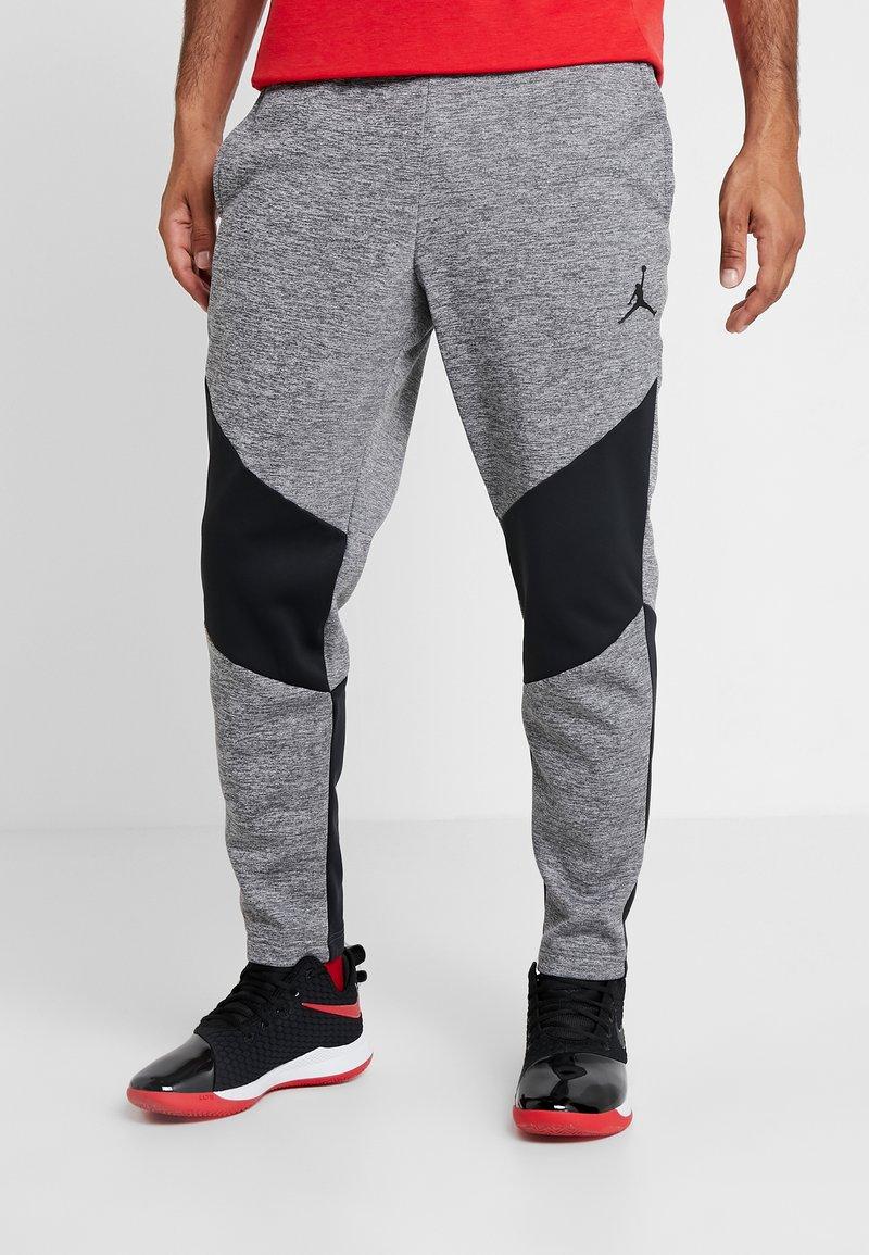 Jordan - ALPHA THERMA PANT - Spodnie treningowe - carbon heather/black