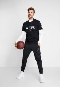 Jordan - ALPHA THERMA PANT - Träningsbyxor - black/white - 1