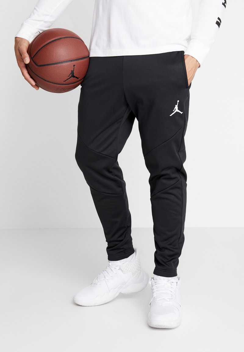 Jordan - ALPHA THERMA PANT - Pantalon de survêtement - black/white
