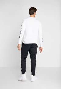 Jordan - ALPHA THERMA PANT - Träningsbyxor - black/white - 2