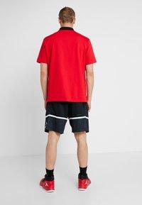 Jordan - JUMPMAN GRAPHIC SHORT - Sports shorts - black/white - 2
