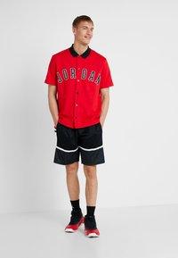 Jordan - JUMPMAN GRAPHIC SHORT - Sports shorts - black/white - 1