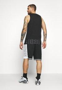 Jordan - JUMPMAN BBALL SHORT - Pantaloncini sportivi - black/white - 2