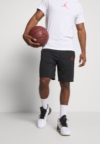 Jordan - JUMPMAN SHORT - Sports shorts - black/black/white/gym red - 0