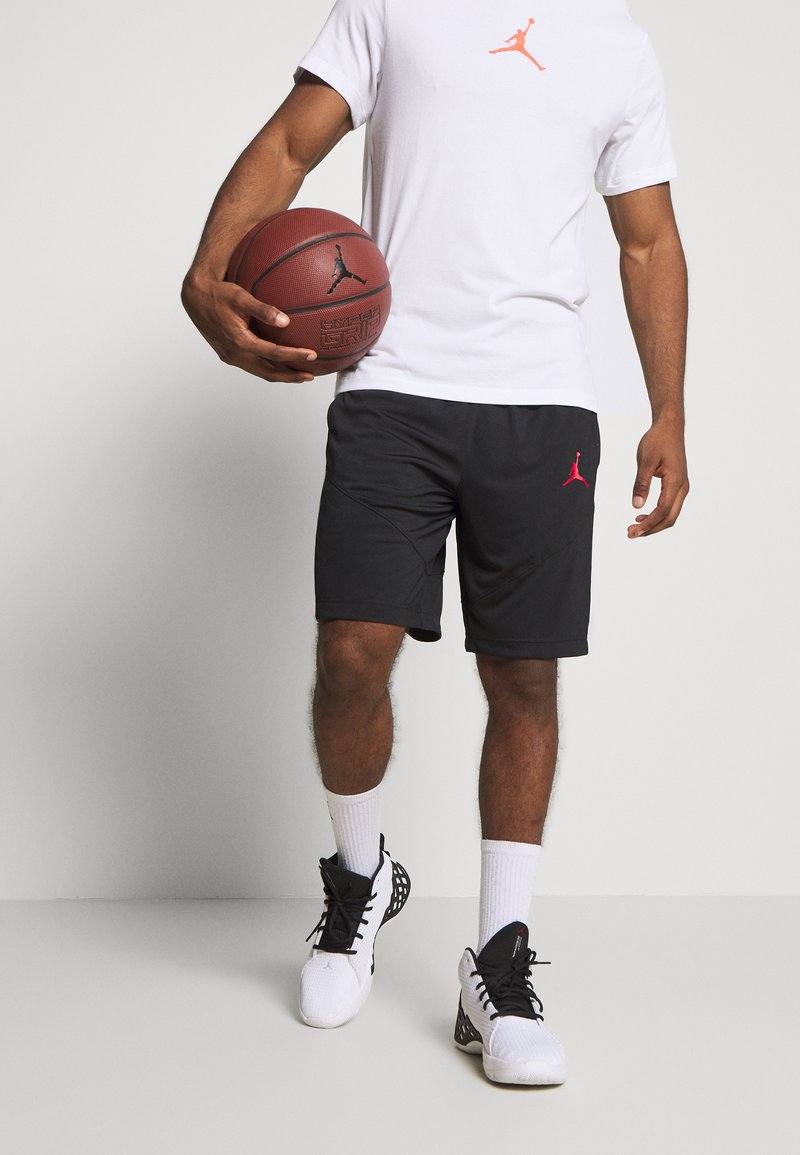 Jordan - JUMPMAN SHORT - Sports shorts - black/black/white/gym red
