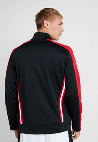 Jordan - JUMPMAN SUIT JACKET - Kurtka sportowa - black/red - 2