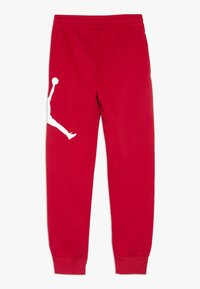Jordan - JUMPMAN LOGO PANT - Teplákové kalhoty - gym red - 1