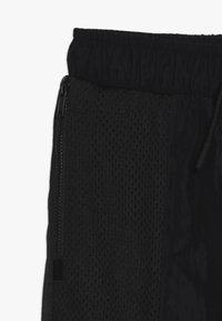 Jordan - AIR SUIT PANT - Teplákové kalhoty - black - 2