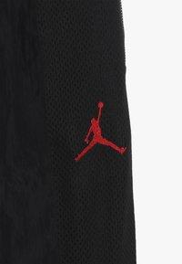 Jordan - AIR SUIT PANT - Teplákové kalhoty - black - 4