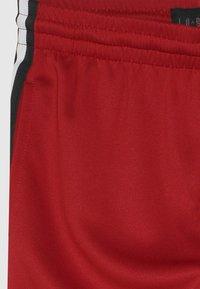Jordan - JUMPMAN AIR SUIT PANT - Teplákové kalhoty - gym red - 3